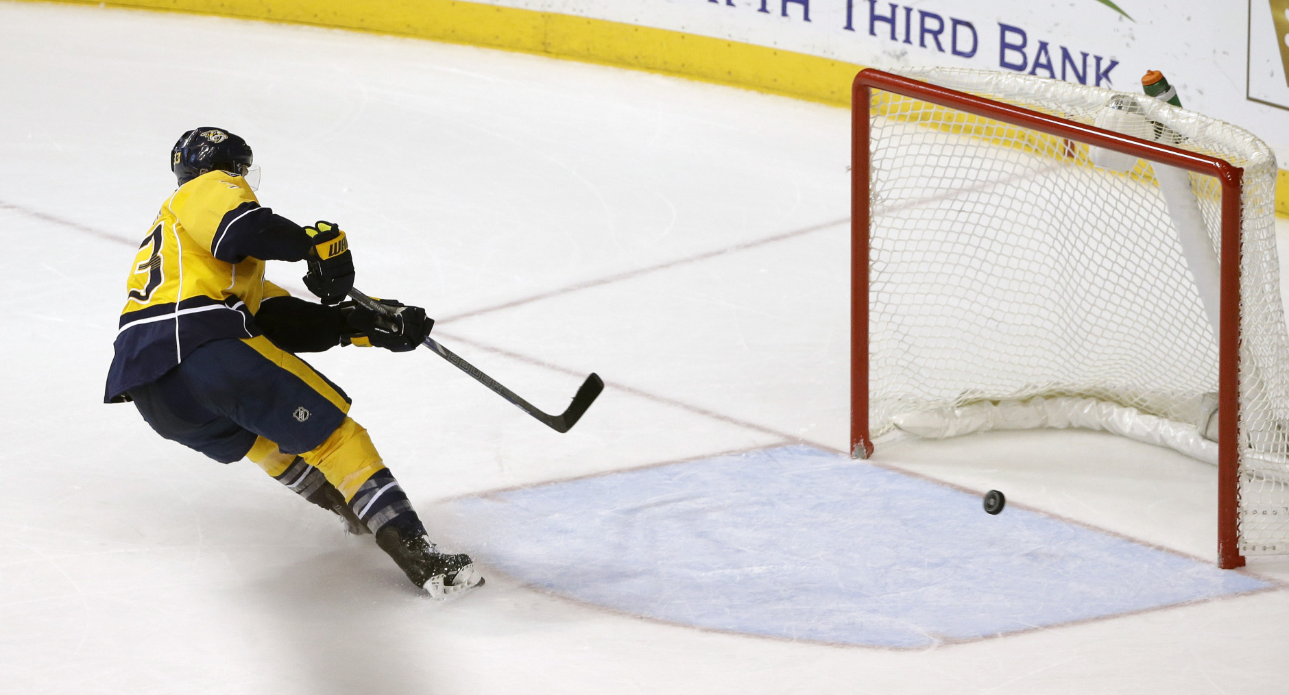 Nashville Predators center Colin Wilson scores an empty net goal against the Philadelphia Flyers in the third period of an NHL hockey game Saturday, Dec. 27, 2014, in Nashville, Tenn. (AP Photo/Mark Humphrey)