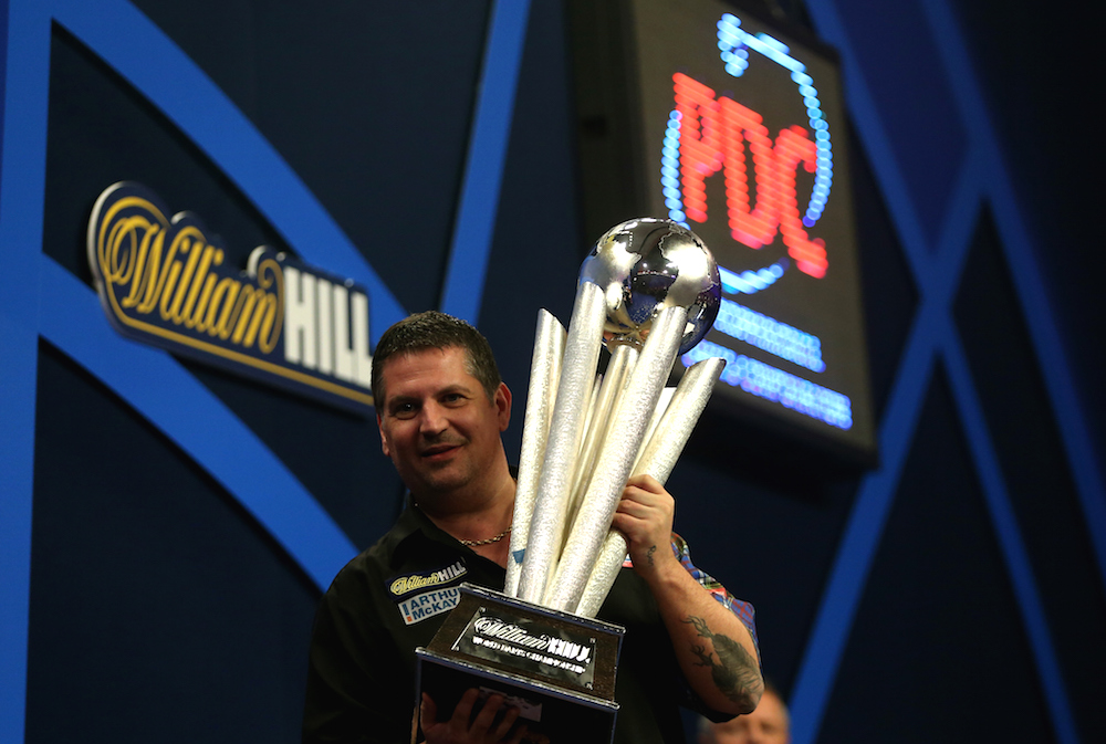 LONDON, ENGLAND - JANUARY 04:  Gary Anderson of Scotland  celebrates with the Sid Waddell trophy after defeating  Phil Taylor of England in the final of the 2015 William Hill PDC World Darts Championships at Alexandra Palace on January 4, 2015 in London, England.  (Photo by Ben Hoskins/Getty Images)